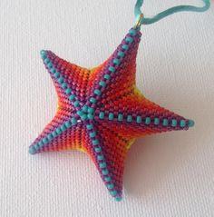 Geometric beaded multi-colour star pendant made from miyuki delicas and seed beads from a Jean Power pattern Seed Bead Jewelry, Seed Beads, Beaded Jewelry, Diy Jewellery, Skull Jewelry, Hippie Jewelry, Beaded Starfish, Stone Plugs, Peyote Beading