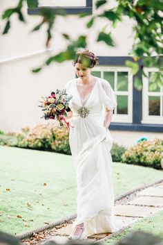 Rebeca wore a Jenny Packham gown alongside Rachel Simpson Mimosa mint shoes for her homemade, Autumn wedding in the Lake District. Photography by Jessica Reeve.
