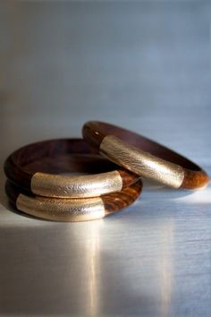 Wood and Gold Leather bangles-- (Raven + Lily is a socially responsible brand dedicated to empowering women through design partnerships and sustainable economic opportunities.)