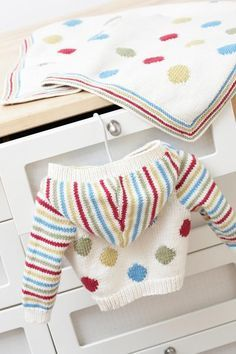 Well spotted…and nicely striped, too. A cardi and blanket set for snuggling up on chilly days.