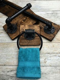 Industrial rustic bathroom set of 3    DESCRIPTIONS: This industrial rustic bathroom set include bath towel holder toilet paper holder and a hand towel ring. Industrial rustic beautiful set of 3. It will make your bathroom outstanding and one of a kind. The wood is custom hand distressed. No two pieces are alike.  Its made out of pipes. Clean and protected for long lasting use. Easy to clean with damp clean cloth.  Its a great piece to any house. New and modern or old with character. Do…