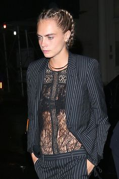 Cara Delevingne braided her crop into two slick plaits.