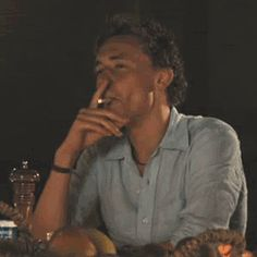 It's like he's modeling smoking.at least those cheekbones are. If you watch this gif enough times it will give you a second-hand lady boner. Tom Hiddleston Loki, Thomas William Hiddleston, Loki Thor, Loki Laufeyson, The Darkness, Thomas Sharpe, Toms, Lady Loki, White Boys