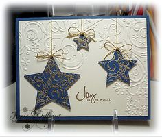 November 12, 2011  Back to Christmas  I used the same Cuttlebug embossing folder, one of a set of five called Winter Wonderland,  as I used on the star cards for this card. Again I used an image that I had previously colored a darling image from Mo's Digital Pencil. I cut it out with scissors and attached it to the card with dimensional tape.      Wednesday, November 9, 2011  More stars  I used the same embossing folder for this card
