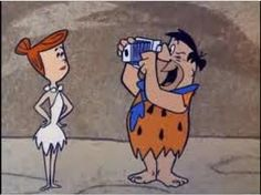 Fred takes a pic of Wilma with his Polarock instant camera