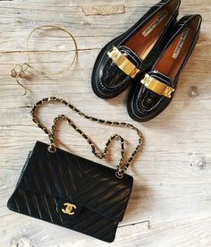 Chanel quilted purse, black Acne Studios loafers with gold hardware