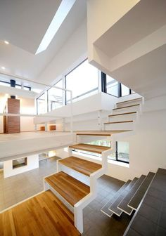 This dramatically cantilevered home in Osaka seems to defy gravity while multiplying available space, providing another example of the clever tricks employed by Japanese architects to make the most of small lots. Though the home is actually three stories tall, Shogo Iwata designed House in Senri with eight tiered interior levels.