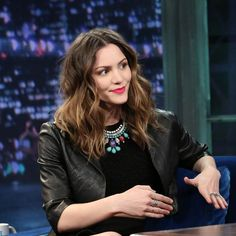 Katharine McPhee is Employing a Trick That Makes Wavy Hair Amazingly Full. The pieces around her face were wound around the barrel of a curling iron back and away to open everything up, but the pieces in the back were curled toward the front. This switch of direction brings all the hair forward, so it's fuller.