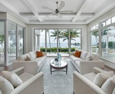 Good Looking Pier One Imports Furniture method Miami Beach Style Living Room Decoration ideas with ceiling fan coffered ceiling floor-to-ceiling windows glass coffee table gray armchair gray rug gray