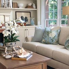 Summer style in the great room. . . . #summerdecor #summerstyle #greatroom #livingroom #familyroom #frenchcountry #blues #greens #coastaldecor #coral #shells #collected #bottles #vintagebottles #savvysouthernstyle