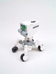 A cute little wheeled bot.