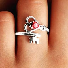 This stunning ring will surely be the key to her heart! Customize with your choice of metal and gemstones. The wraparound heart key design is truly unique and makes a stylish statement.