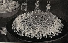 Lovely Irish Rose Crocheted Doily Pattern with Ruffle  This doily, medium in size, has the lovely Irish Rose Motif n implied rings among the lacy center, and then bordered with a high semi-tall ruffle all the way around the edges.