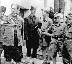 Photograph of Yugoslavian collaborators turning in a captured partisan to the German army.