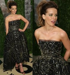 Kate Beckinsale in a Monique Lhuillier strapless tulle dress featuring gold embroidery at the 2013 Vanity Fair Oscar party at Sunset Tower in Los Angeles, California on February 24, 2013