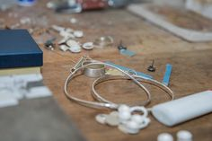 Bespoke jewellery by artisan in her studio.  Commercial lifestyle photography.