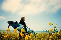 Surfer in flowers, Northern California.