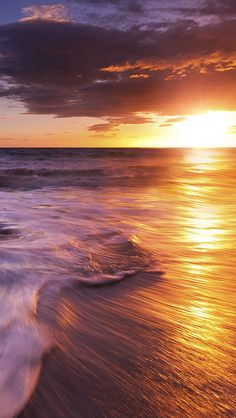 Sea water waves and sunset