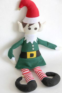Make your own Elf on a Shelf with the free, downloadable pattern and tutorial from #WeAllSew! We think this cheery little elf is much cuter than the one who sits on shelves! Prop this adorable Santa's helper next to your sewing machine. If you're lucky, he might even use a little magic to do some stitching while you sleep! Diy Christmas Elves, Christmas Sewing, Diy Christmas Ornaments, Holiday Crafts, Holiday Ideas, Christmas Applique, Felt Diy, Felt Crafts, Stuffed Animal Patterns