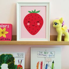 This fun and fruity art print adds a pop of cuteness to any kids room or nursery. Create an atmosphere of joy in your little ones room and dare them not to smile at this happy strawberry. Comes in fiv
