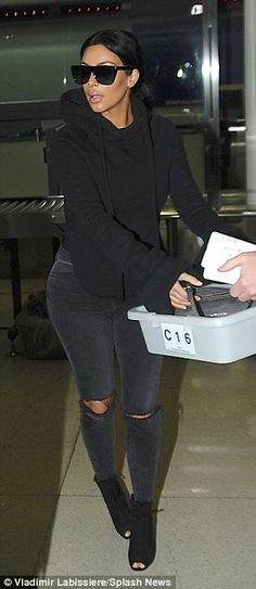 She's just like us: The 34-year-old reality star doffed her chic booties and walked barefoot through the metal detector during security check point at LAX