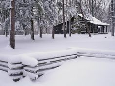 nothing better than a cabin in the woods surrounded by snow!