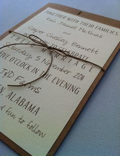 I like the fonts used in this invitation with a simple brown bow. Topped off with lace or doily on side would be perfect.