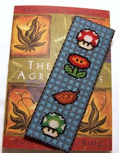 cross stitch power up bookmark -- this could be arts & crafts...AND...an awesome geek-reader keepsake!