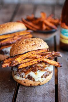 Homemade quinoa burger topped with sweet potato fries, beer caramelized onions and gruyere #recipe