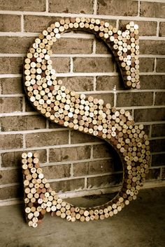 Recycled wine cork wooden letter-could make this 'L' for guestbook table. Collect corks from wineries.