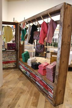 Visual Merchandising | Display | Wooden racks/display #shop #clothing #display: