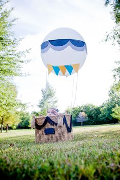 Playful family portraits in a DIY hot air balloon. Photographed by Steadfast Studio.