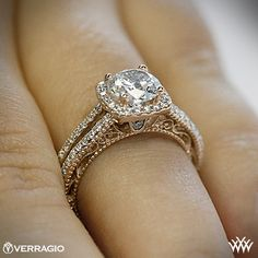 Think this is absolutely stunning. I love rings with a vintage feel. I also love the halo design. :D Verragio Split Shank Pave Diamond Ring