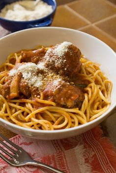 NYT Cooking: These are the meatballs you want to serve with spaghetti sauce — my mother Anne Marie Zappa's is the one I'd use, but your favorite will work as well. Key to the recipe is a light hand in the mixing.