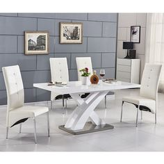 Axara Extending Small Dining Table In White High Gloss With 6 Vesta White Dining Chairs Features: •Axara Extending Small Dining Table White High Gloss And 6 Vesta White Dining Chairs •Axa...
