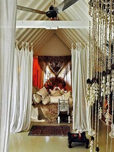 lovely. I like the curtains strung on twine.. so bohemian. I'd go for this when we finally have a larger bedroom.