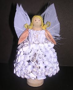Angel created from strips of paper that are coiled and glued into place. The body is a dolly peg and the wings are feathers. created as park of the Uk craft forum christmas quill along Quilling Christmas, Christmas Crafts, Christmas Decorations, Christmas Ornaments, Paper Angel, Felt Angel, Paper Art, Paper Crafts, Diy Crafts