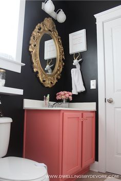Sources:   Vanity Color: Behr Wild Watermelon   Mirror: Thrifted   Flowers: Homegoods   Towel: w...