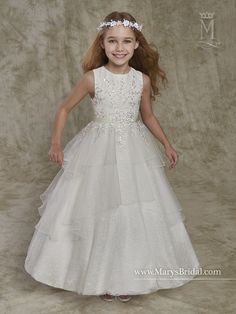 Jewel neck tulle and lace flower girl ball gown with tiered skirt, floral lace and bead appliques, satin belt, and back zipper.