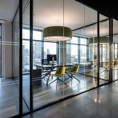 Glass-walled private office space at Biotronik in NYC | design by Ted Moudis…