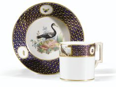 A TOURNAI SOFT-PASTE PORCELAIN CUP AND SAUCER FROM THE SERVICE OF THE DUC D'ORLÉANS, CIRCA 1787
