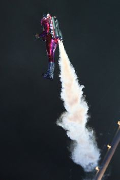 A performer with a jetpack takes part in the Opening Ceremony of the London 2012 Olympic Games at the Olympic Stadium on July 27, 2012 in London, England.