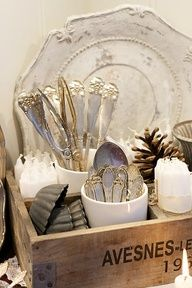 ❥ old silverware displayed in crate