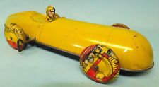 Marx prototype boat tail race car wind-up tin toy w/driver.