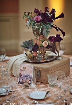 """""""The use of old vintage suitcases as a Beautiful party centerpiece!"""" Which of course would never work. But it makes a pretty picture."""