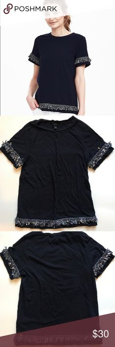 Navy Blue Fringe Banana Republic Top Navy blue short sleeve shirt from banana republic. Silver, blue and white fringe made out of string and beads on the sleeves and on the bottom of the shirt. In good condition! Bundle up or feel free to leave an offer! Banana Republic Tops Tees - Short Sleeve