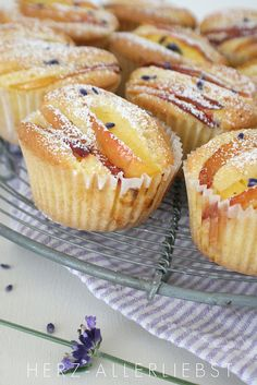 Lavender Nectarine Muffins || Recipe (translation):  120g butter,  150g sugar (part of it lavender sugar),  vanilla pulp of one pod,  2 eggs,  200g flour,  1 1/2 teaspoons baking powder,  2 tablespoons cream  - mix everything;  nectarine-slices on top ||  bake 30min (170°)