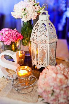 Rustic decor, which included floral arrangements and elaborate lamps, offered a pretty view at the reception. | www.BridalBook.ph