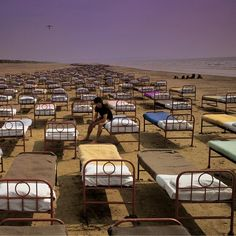 "Pink Floyd ""A Momentary Lapse of Reason"", Storm Thorgerson cover. The cover shows hundreds of hospital beds, placed on Saunton Sands in Devon (where some of the scenes for Pink Floyd The Wall were filmed)."