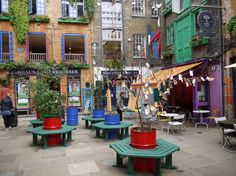Note 55 gallon drums serving as attractive planters. Neal's Yard, London // SilverTiger